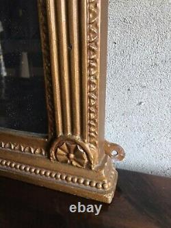Gilt frame wall hanging mirror flanked each side with small mirrors