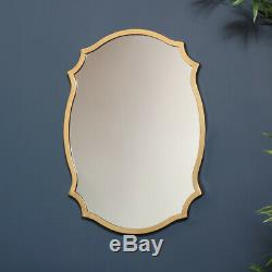 Gold wall mirror decorative shaped metal frame vintage luxe living room hallway