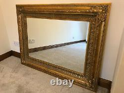 Large ornate gold / gilt framed wall mirror