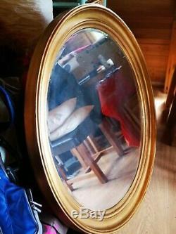 Very large circular gold framed wall mirror