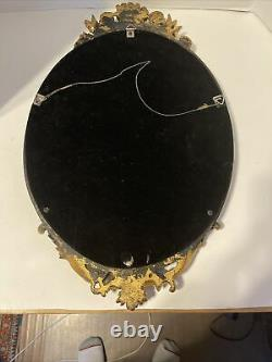 Vintage Mid Century Oval Wall Mirror with Gold Color Ornate Frame. (Trkng ALST)