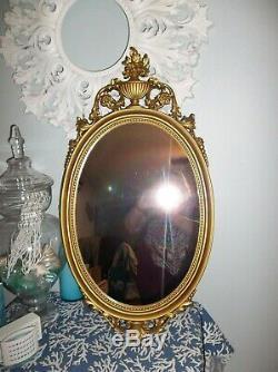 Vintage Syroco 31x16 Gold Ornate Framed Wall Mirror Hollywood Regency Urn Flower
