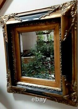 Vintage wall mirror is small but very stylish and beautiful frame black and gold